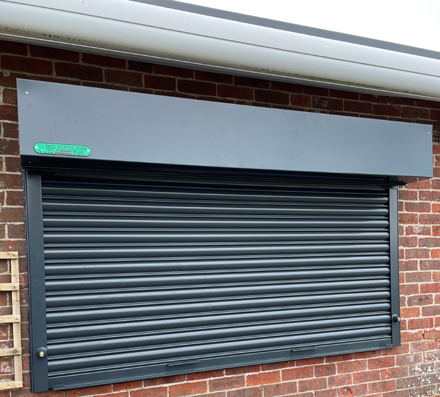 Roller shutters at a cafe